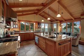 cathedral ceiling kitchen lighting ideas craftsman kitchen with wall sconce undermount sink in