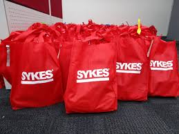 sykes welcomes new hires with holiday gift bags sykes philippines