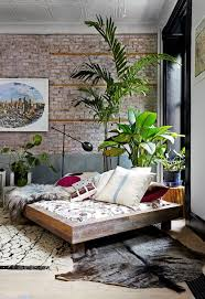 awesome tropical bedroom with house plants and wooden platfrom bed