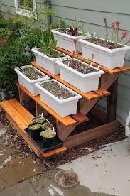 Easy Diy Garden Decorations Diy Tiered Plant Stand Garden Gardening Garden Decor Small Garden