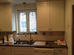 do you tile under kitchen cabinets subway tile looks uneven under cabinet lighting