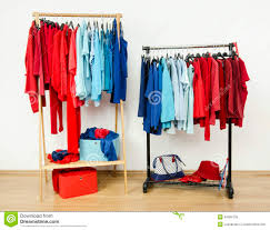 Wardrobe Clothing Wardrobe With Red And Blue Clothes Hanging On A Rack Nicely