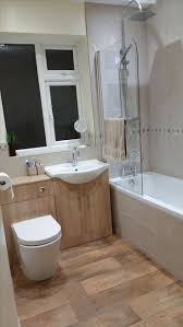 best 25 shower over bath ideas on pinterest moroccan bathroom the back to wall toilet unit and oak vanity unit both come from the sienna range