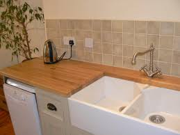 furniture for kitchen decoration using dark brown travertine tile