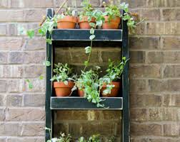 planters that hang on the wall wall planter etsy