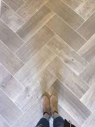 love wood tile in a herringbone pattern such a great look and so
