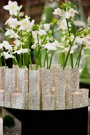 christmas centerpiece with white flowers in sparkling small slim