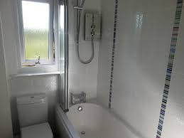 bathroom s paladin kitchens white bathroom suite inbuilt vanity unit with porcelain sink and mono taps 500mm x 250mm square pattern tiles with mosaic insert