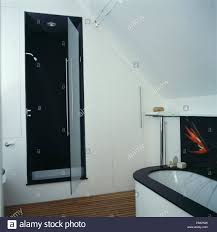 recessed shower cabinet with glass door open in modern white loft