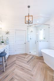 master bathroom with herringbone wood floor marble shower and