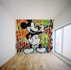 indo prolific pop street stencil artist australia sydney large graffiti street art mural of mickey mouse by indo the artist byron bay office space