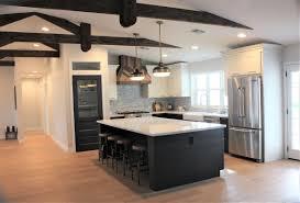 black kitchen cabinets farmhouse modern farmhouse by rafterhouse black shiplap island white