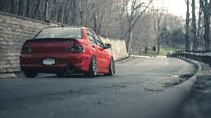 mitsubishi evo red cars forests mitsubishi lancer evolution ix red roads tuned tuning