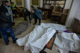 file dead bodies in a makeshift hospital and morgue in the hotel