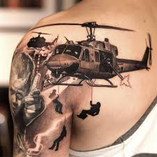 upper back and sleeve cover up with simple 3d helicopter and army men tattoo jpg