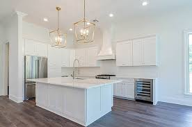 oversized kitchen island with custom lighting the parks of