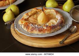 breton en cuisine galette with pears on black background cuisine