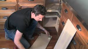 how to install kitchen base cabinets how to install bi fold lazy susan cabinet doors youtube
