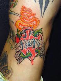 burning heart with mom banner tattoo on lower back tattooshunter com