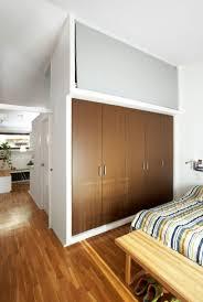 furniture grey long sofa wooden chair sooden floor fireplace ideas