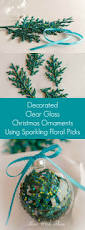 decorated clear glass christmas ornaments using sparkling floral picks