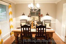 remodelaholic dining room lighting tablescape and chevron