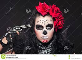 halloween woman mask young in day of the dead mask with gun royalty free stock
