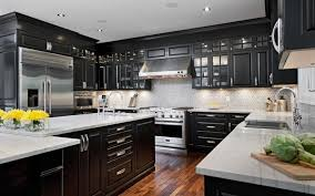 elegant kitchen featuring black cabinets with white countertops