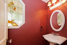 pleasant tiny red bathroom decorating ideas with rounded mirror