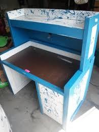 blue acrylic cube that conceals a secret desk arrangement when