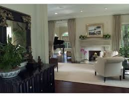 recessed lighting over fireplace baseboards recessed lighting ceiling drapes wood flooring open floor
