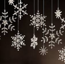 snowflakes hanging by fishing line or tiny ribbons my