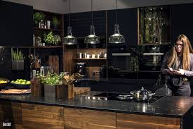 Kitchen Islands With Cooktops by Wooden Island With Black Marble Countertop Electric Cooktop