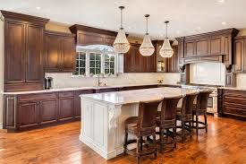 wood kitchen cabinets with white island brown kitchen with white island traditional kitchen