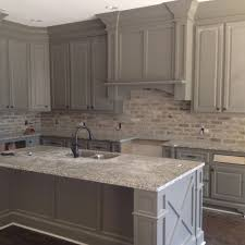 what color backsplash with gray cabinets the brick backsplash color against the grey cabinets