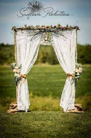 wedding arches names 20 with windows and lanterns flowers and greenery 53