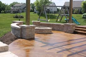 Backyard Concrete Patio by Come Join Us Acid Stained Concrete Patio With Tumbled Stone Seat