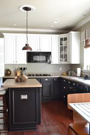 red oak wood light grey shaker door black and white kitchen