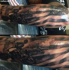 beautiful army sniper and american flag tattoo made on forearm