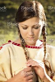 free mative american braids for hair photos young native american woman looking down at her braids stock photo