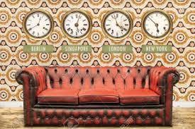 Chesterfield Sofa History Retro Chesterfield Sofa With World Time Clocks On A Wall With