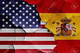 The Flag Of Usa Flags Of Usa And Spain Painted On Cracked Wall Stock Photo