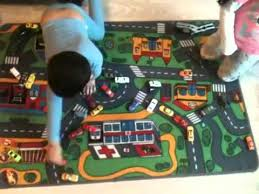 Childrens Play Rug by Kids Playing Diecast Cars On Car Play Mat Youtube