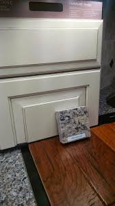 a bright white opaque glazed cabinet finish creating a smooth