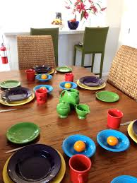 dining room colorful diningware set by fiestaware on wooden