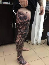 black ink samurai tattoo on man right full leg