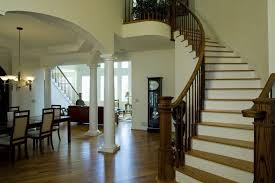 traditional staircase with arched wall hardwood floors in east