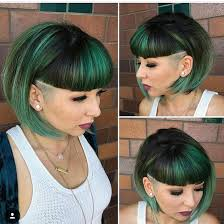 photos of short hair for someone in their sixes this emerald green undercut bob with blunt baby bangs is a great