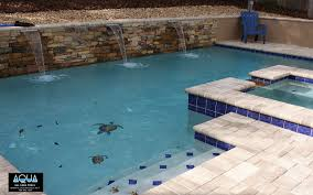 modern pool with rock wall all aqua pools modern pool with turtle mosaics and blue tile