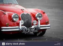 jaguar front the front grill of an old red jaguar car stock photo royalty free